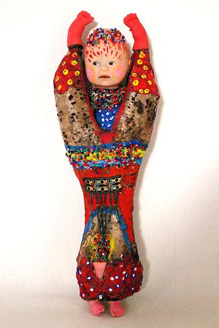 2006 - L'Enfant - collage et assemblage d'éléments divers sur racine - peinture à l'eau - 35x17x8 cm